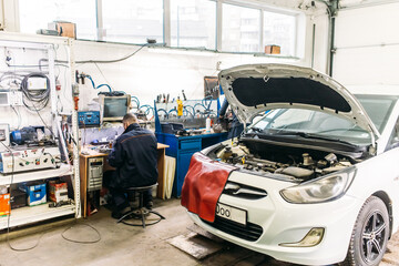 Obraz car service, cars are in the workshop for repair, general view - fototapety do salonu