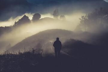 Obraz man walking in a foggy autumn landscape - fototapety do salonu