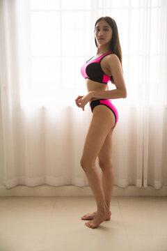 asian woman sexy  wearing pink bikini in her room.