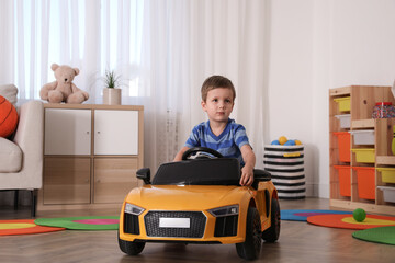 Obraz Little child playing with toy car in room - fototapety do salonu