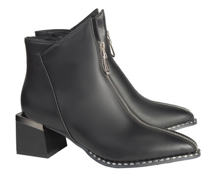 Stylish black women's boots made of genuine leather isolated on a white background.