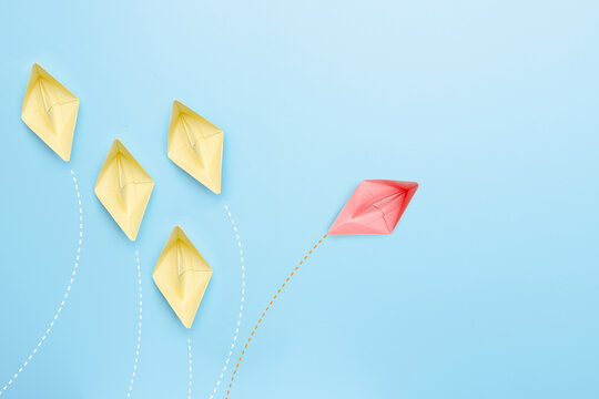 paper boat have different thinking and lead to travel other way, leader and individual symbol concept