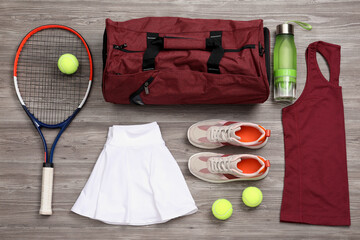 Obraz Sports bag and tennis equipment on wooden background, flat lay - fototapety do salonu
