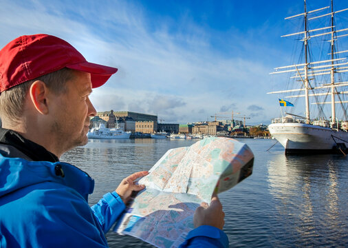 Stockholm tourists looking at map, focus on the hand