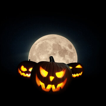 Scary glowing pumpkin with a full moon on a black background. Halloween wallpaper at night