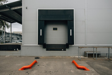 Fototapeta Closed door of transport terminal for truck deliveries and loading obraz