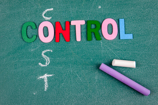 Cost Control concept. Colored wooden letters on a green chalk board