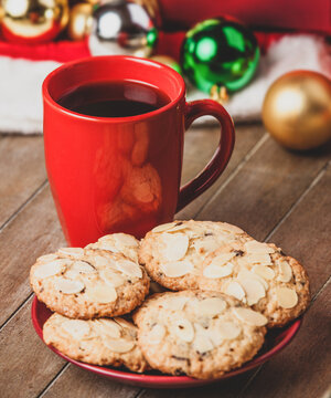 Cookies and cup of coffee with christmas gifts at background