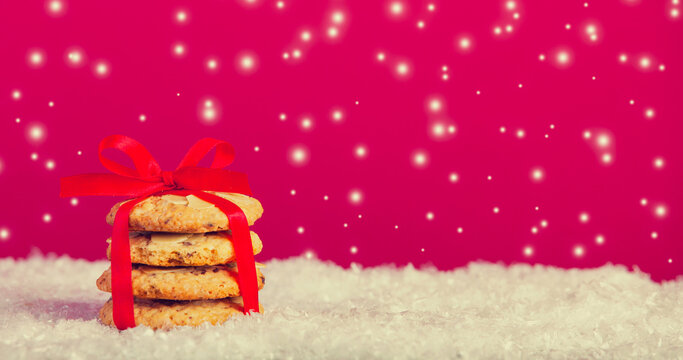 Christmas cookies and snow at background