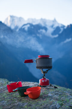 A gas stove with a pan of boiling water for a breakfast in the mountains near Chamonix.