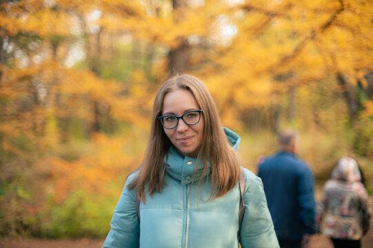 Autumn portrait of beautiful woman on fall nature background