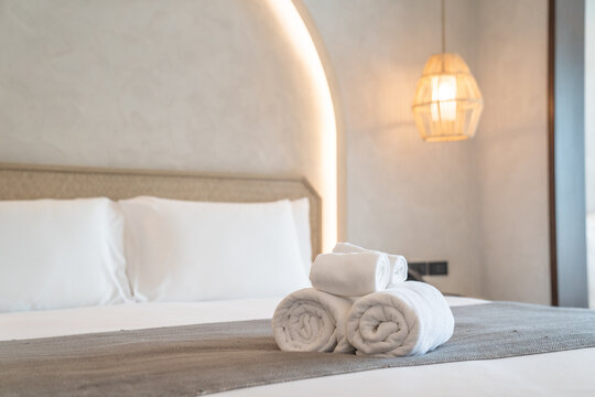 White towels on bed decoration in stylish bedroom interior
