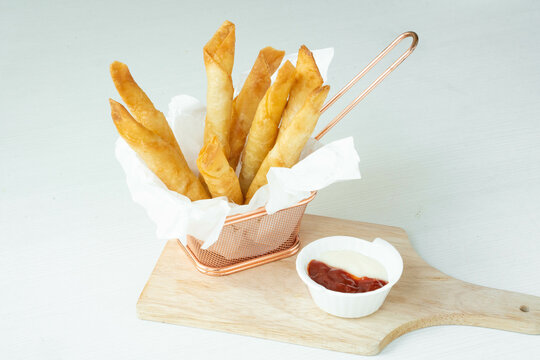 Homemade Fried Breaded mozzarella cheese sticks served with tomato sauce and mayonnaise on white background