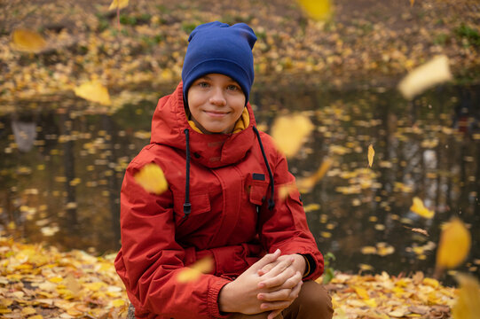 Autumn portrait of boy teen on fall nature background