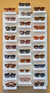 A lot of sunglasses for sale on the stand in the street