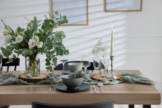 Festive table setting with beautiful tableware and decor indoors