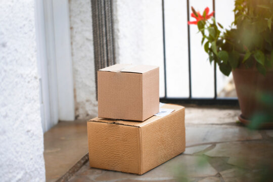 Two boxes on front door. Delivery, online shopping concept