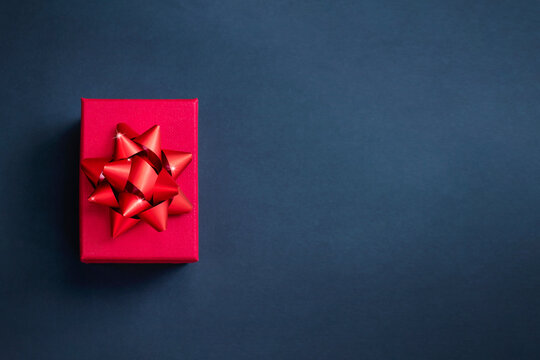Top view of red present box on black background