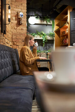 Beautiful woman having cup of coffee at cafeteria