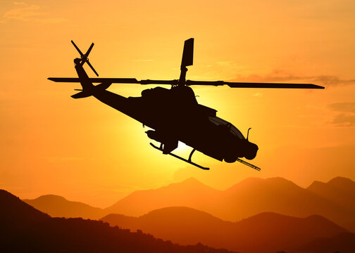 American attack helicopter silhouette in the flight