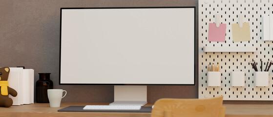 Fototapeta Teen's home working desk, Mockup of a modern computer blank screen on a table obraz