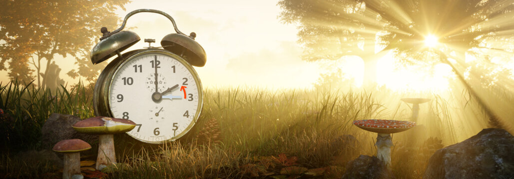 Fall Back Time. Return to wintertime. Daylight Saving Time concept. Alarm clock in Autumn landscape with sunset or sunrise in the background. 3D rendering.