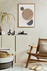 Obraz Stylish and modern beige living room interior composition with mock up poster frame, beige wooden sideboard, armchair and boho inspired accessories. Copy space. Template. - fototapety do salonu