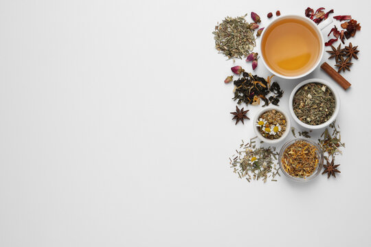 Composition with fresh brewed tea and dry leaves on white background, top view