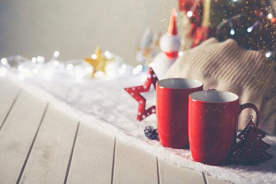 Couple red mugs on Christmas