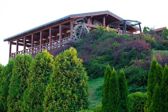 Wooden restaurant with a water mill on the mountain
