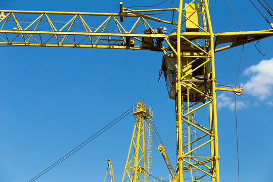 Tower cranes with hydraulic boom lift. Tower cranes on the construction of a new residential building.