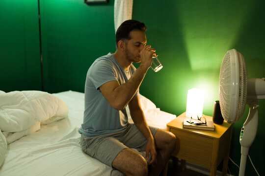 Man waking up because of a warm night