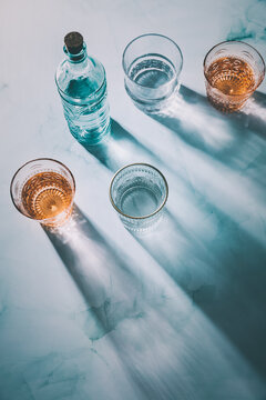 Water in vintage glasses and bottle