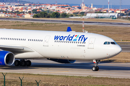 World2Fly Airbus A330-300 airplane Lisbon airport in Portugal