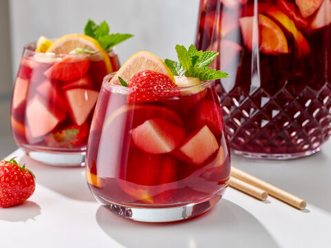 close up of red sangria glasses