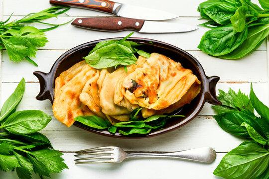 Azerbaijani qutab with greens and cheese