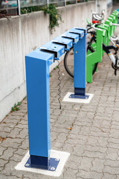 transport and sustainability concept - electric scooter parking and charging station in city