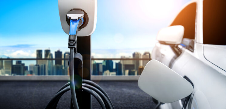 EV charging station for electric car in concept of green energy and eco power produced from sustainable source to supply to charger station in order to reduce CO2 emission .