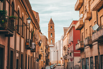 Old street with a tower in Italy