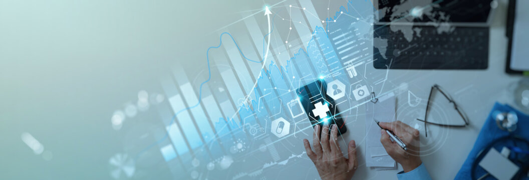 Healthcare and Medical business vitual graph data and growth with Medical examination and doctor analyzing medical report network connection on smartphone.