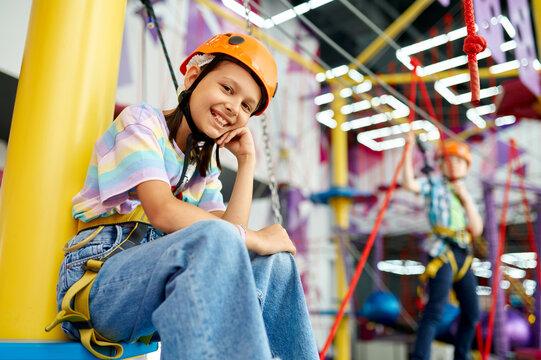 Happy girl in climbing area
