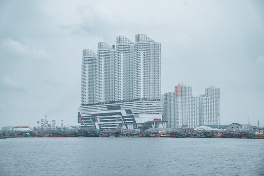 Beautiful view of tall skyscrapers on the seashore in Jakarta city, Indonesia on a gloomy day