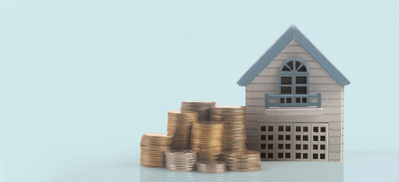 Model of detached miniature house mock and coins