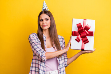 Fototapeta Photo of young woman unhappy sad dislike refuse present box surprise birthday isolated over yellow color background obraz