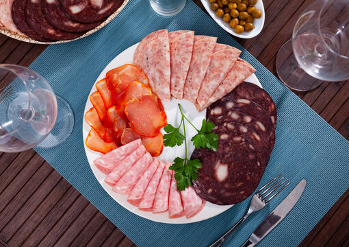 Appetizer of various types of Spanish sausages on platter