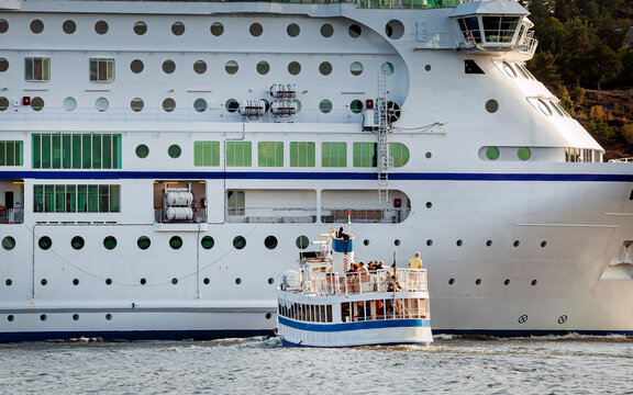 Local ferry waiting for big Cruise liner to pass, Sweden, Stockholm