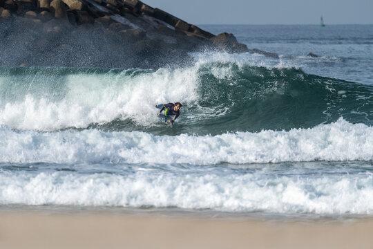 Bodyboarder riding a wave
