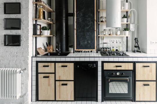 Kitchen in black, white and wood minimalist interior design
