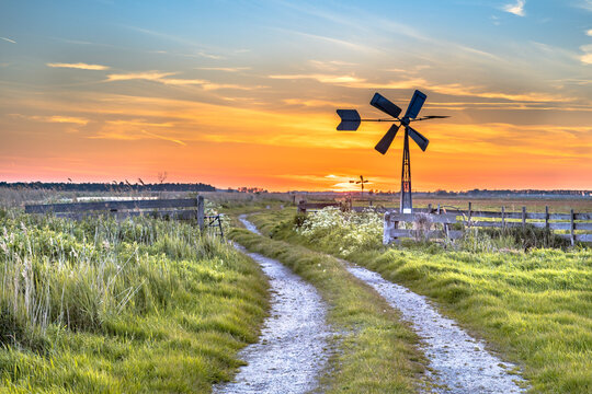 Old windmill in agricultural landscape