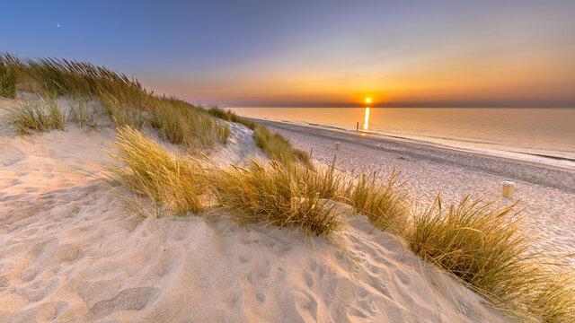 Sunset View over ocean from dune in Zeeland